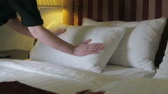 Woman runs the linen on the bed Stock Footage