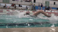 Man swimming freestyle closeup sideview slomo in olympic size pool Stock Footage