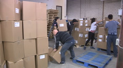 Aid workers from Global medic package aid for Ecuador earthquake victims Stock Footage