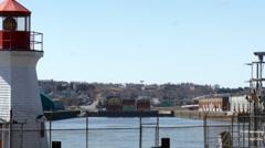 Coast guard lighthouse in city harbour  - harbor - port Saint John New Brunswick Stock Footage
