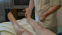Specialist is making a massage to disabled person Stock Footage