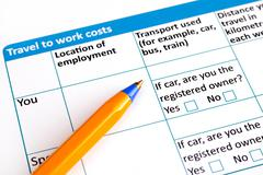 Travel to work costs application form with ballpoint pen Stock Photos