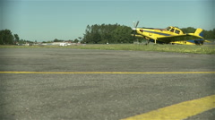 Portuguese aerodrome with an yellow airplane parked Stock Footage