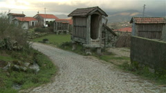 Village with typical stone corn drier, called Espigueiro, in north of Portugal. Stock Footage