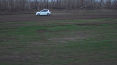 The white car rushes on field - stock footage