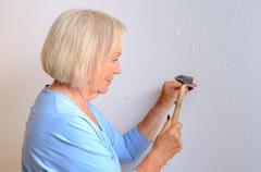 apable elderly woman doing DIY - stock photo
