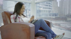 Hispanic Woman with a tablet in condo in urban 4K - stock footage