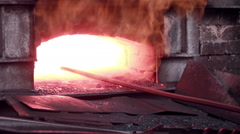 Woman working with Liquid molten metal melted in furnace at metallurgical plant Stock Footage