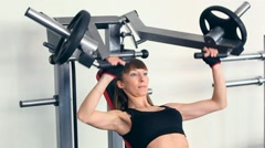 Strong young brunette woman training in sport gym - stock footage