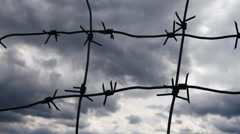 Sky and Barbed Wire - stock footage