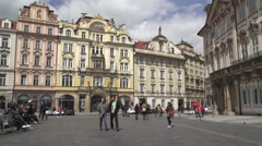 People walk in the Prague  Old Town square on a sunny day in spring 2016 Stock Footage