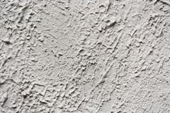 gray plaster on a wall with cracks - stock photo