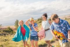 Young man and female friends playing ukulele and walking in hills, Bridger, Kuvituskuvat