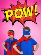 Composite image of masked kids pretending to be superheroes - stock photo
