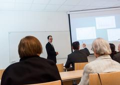 Speaker interacting with the audience at presentation. - stock photo