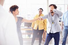 Colleagues in team building task, holding hands covering eyes Stock Photos