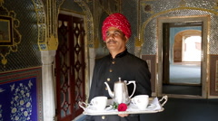 Waiter carrying tea tray, Samode Palace, Jaipur, Rajasthan, India Stock Footage
