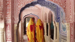 Elegant ladies in Saris walking in Samode Palace, Jaipur, Rajasthan, India Stock Footage