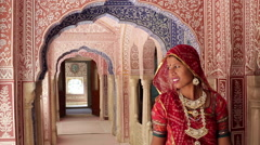 Elegant lady in Sari walking in Samode Palace, Jaipur, Rajasthan, India Stock Footage