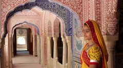 Elegant lady in colourful Sari, Samode Palace, Jaipur, Rajasthan, India Stock Footage