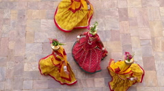 Women dancing in colourful Saris, Samode Palace, Jaipur, Rajasthan, India Stock Footage