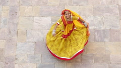 Woman dancing in colourful Sari, Samode Palace, Jaipur, Rajasthan, India Stock Footage