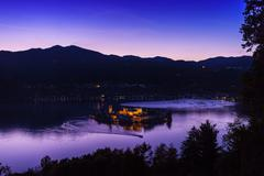 Silhouetted view of Lake Orta at night, Orta San Giulio, Piedmont, Italy Stock Photos