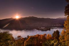 Sunlit view of Lake Orta, Orta San Giulio, Piedmont, Italy - stock photo