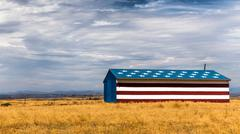 Barn in field painted with stars and stripes, California, USA Stock Photos
