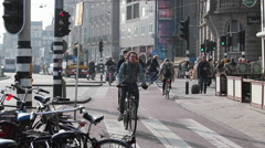 People riding bicycles in Amsterdam, Holland. Prins Hendrikkade Stock Footage