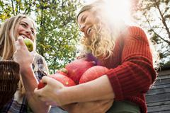 Two women holding homegrown produce, low angle Stock Photos