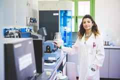 Female scientist and Thermogravimetric/Differential Thermal Analyzer Stock Photos