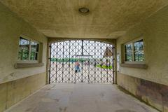 Dachau, Germany - July 30, 2015: Final gate entrance into concentration camp - stock photo