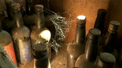 Shot of wine bottles in an old wine cellar, with cobwebs. Stock Footage