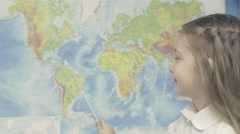 Happy Little Girl Smilesin Front of World Map in Shool Stock Footage