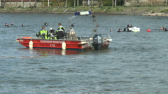 Firefighter lifeboat patrolling on River Rhine - stock footage