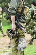 Men in military uniform with weapon Stock Photos