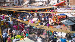 Busy street scene in the Old City, Udaipur, Rajasthan, India, 4K timelapse - stock footage