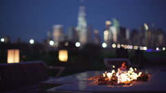 Urban Fire Pit with city skyline Stock Footage