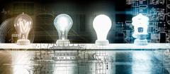 Evolution of the light bulb - from Thomas Edison to energy saving bulb Stock Photos