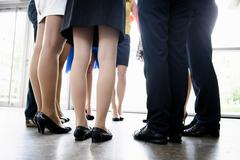 Business peoples legs in office Stock Photos