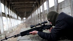 A sniper in the mask shoots lying. - stock footage
