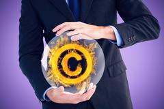 Composite image of mid section of a businessman presenting with his hands - stock photo