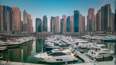 Dubai Marina at early morning hour timelapse with yachts Stock Footage