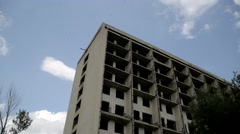 An abandoned nine story building. - stock footage