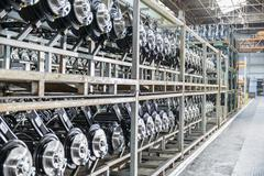 Large number of axles on shelving unit in car plant - stock photo