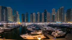 Dubai Marina at Blue hour night to day timelapse with yachts - stock footage