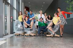 People playing on new office furniture - stock photo