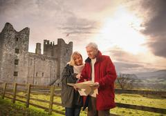 Couple with map visiting Bolton Castle, a 14th century Grade I listed building Stock Photos