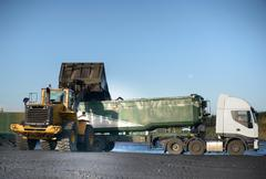 Coal being loaded onto truck at surface coal mine Stock Photos